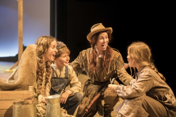 <p>Anna-Jane Casey (Annie Oakley) and the juvenile cast of <em>Annie Get Your Gun</em></p><br />© Johan Persson