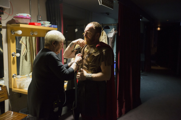 <p>Antony Byrne (Mark Antony) gets into his costume with the help of his dresser</p><br />© Andrew Fox