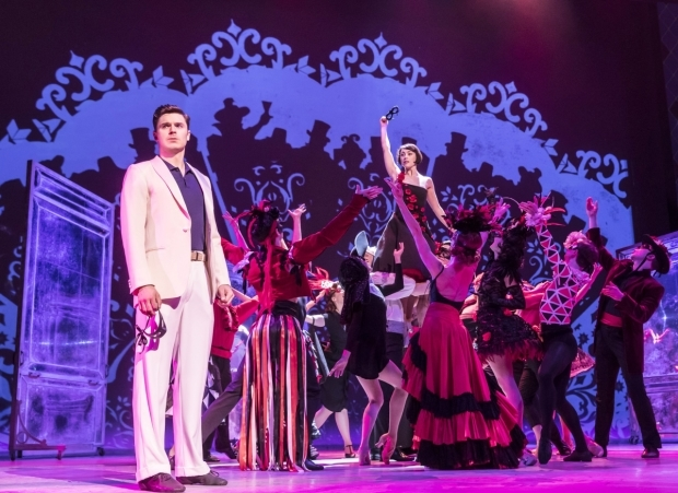 <p>Ashley Day with the cast of <em>An American in Paris</em></p><br />© Johan Persson