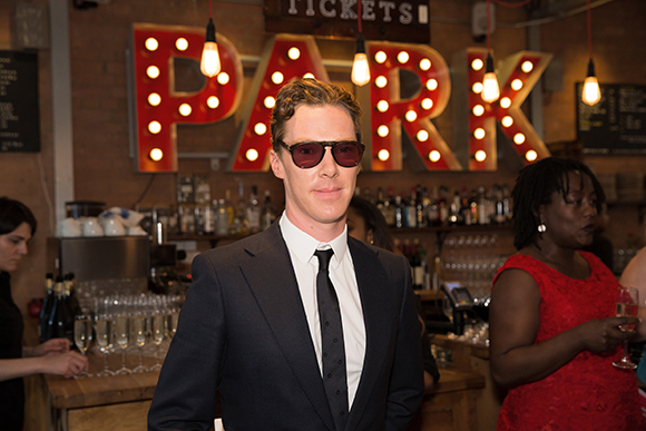 <p>Benedict Cumberbatch protects his eyes from the glare of the Park sign</p><br />© Mark Douet