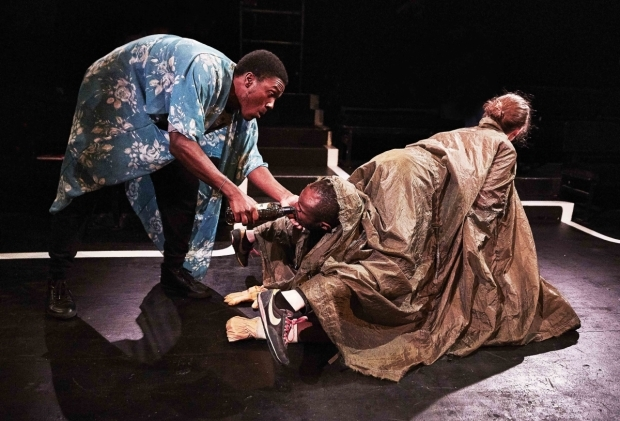 <p>Benjamin Cawley as Stephano, Stanton Plummer-Cambridge as Caliban and Gemma Lawrence as Trincula in <em>The Tempest</em></p><br />© Matt Veal