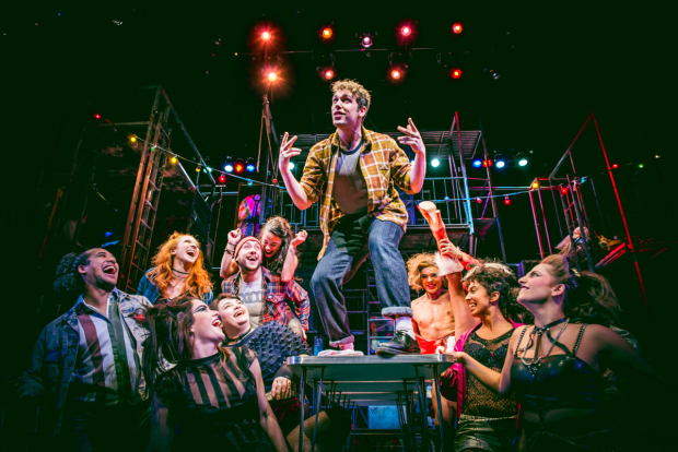 <p>Billy Cullum (centre) as Mark with the cast of the UK tour of <em>Rent</em></p><br />© Matt Crockett
