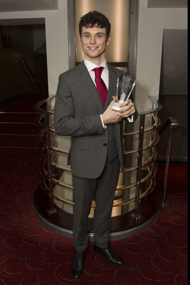 <p>Charlie Stemp accepts the award for Best Actor in a Musical for <em>Half a Sixpence</em></p><br />© Dan Wooller for WhatsOnStage