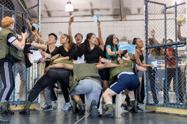 <p>Company of <em>Miss Saigon</em> in rehearsals</p><br />© Manuel Harlan