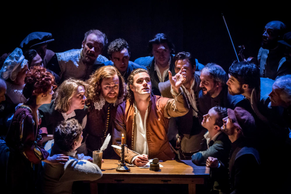 <p>The company surround Tom Bateman as Will Shakespeare</p><br />© Johan Persson
