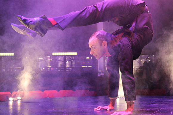 <p>Contortionist Jonathan Nosan performs on stage in <em>Limbo</em></p><br />© Ben Hewis