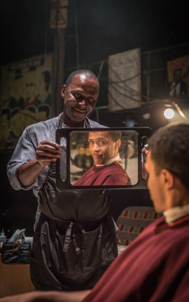 <p>Cyril Nri (Emmanuel) Kwami Odoom (Ethan) in <em>Barber Shop Chronicles</em></p><br />© Marc Brenner