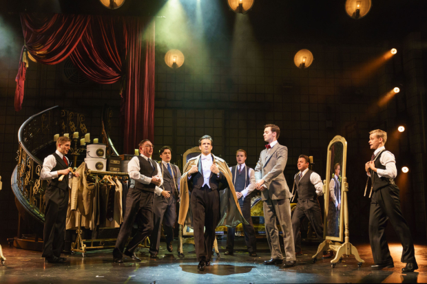 <p>Danny Mac as Joe Gillis and the company of  <em>Sunset Boulevard</em></p><br />© Manuel Harlan