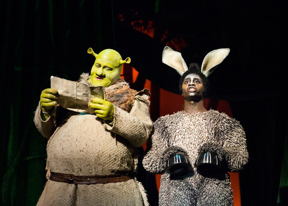 <p>Dean Chisnall as Shrek with Idriss Kargbo as Donkey</p><br />© Helen Maybanks