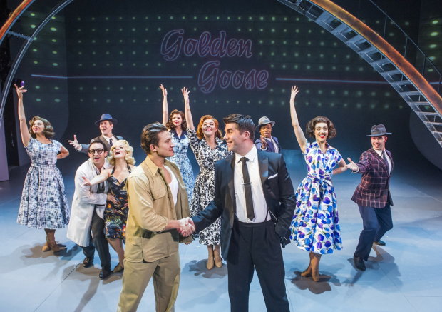 <p>Dean John-Wilson, Simon Lipkin and the cast of <em>Miss Atomic Bomb</em></p><br />© Tristram Kenton
