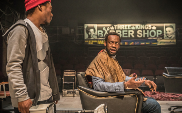 <p>Fisayo Akinade (Samuel) and Sule Rimi (Benjamin) in <em>Barber Shop Chronicles</em></p><br />© Marc Brenner