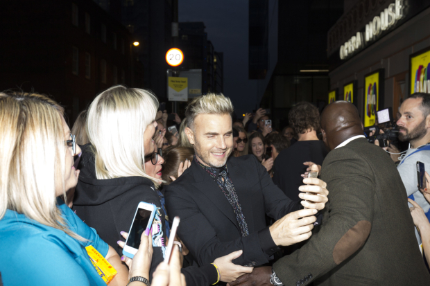 <p>Gary Barlow with fans</p><br />© Phil Treagus