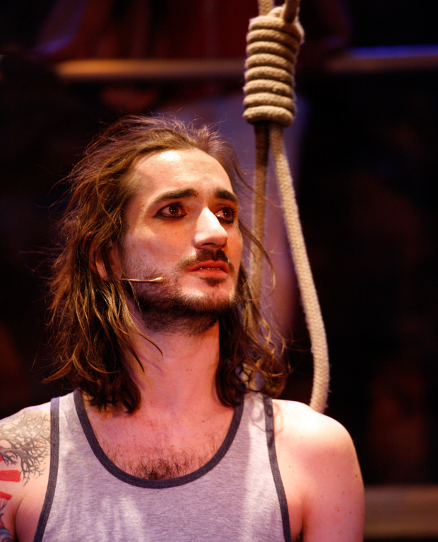 <p>George Maguire  in <em>The Buskers Opera</em></p><br />© Simon Annand