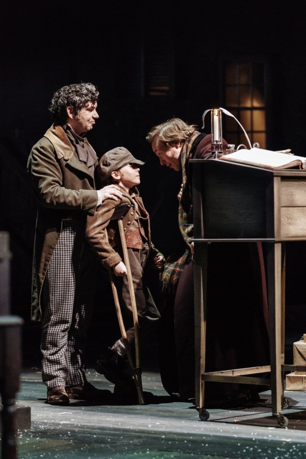 <p>Gerard Carey as Bob Cratchit, Noah Brignull as Tim, and Joseph Prowen as Fred</p><br />© Manuel Harlan