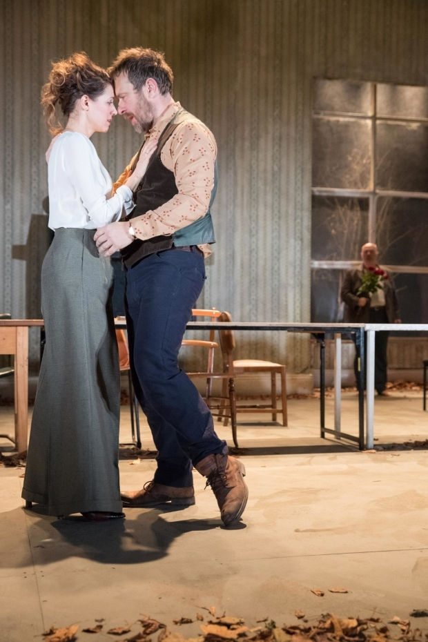 <p>Hara Yannas (Yelena), Jason Merrells (Astrov), and Nick Holder (Vanya, background)  in <em>Uncle Vanya</em></p><br />© Jonathan Keenan