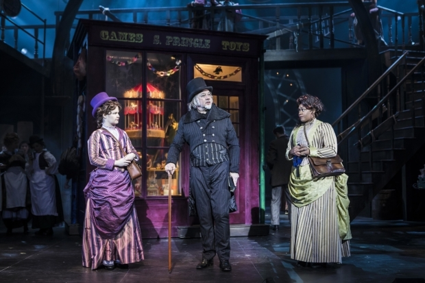 <p>Hollie Taylor as Jocelyn Jollygoode, Jasper Britton as Ebenezer Scrooge and Bree Smith as Henrietta Harty</p><br />© Pamela Raith