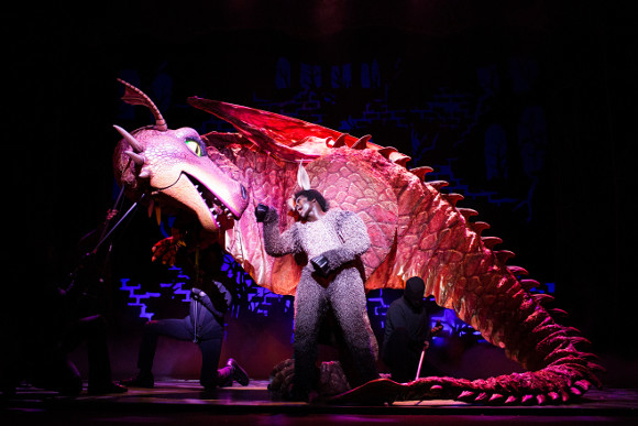 <p>Idriss Kargbo as Donkey with the Dragon</p><br />© Helen Maybanks