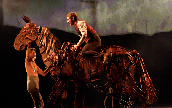 <p>Jack Holden as Albert in <em>War Horse</em>, with Toby Olie, Thomas Wilton and Michael Brett as Joey (premiered at the NT in 2007)</p><br />© Catherine Ashmore
