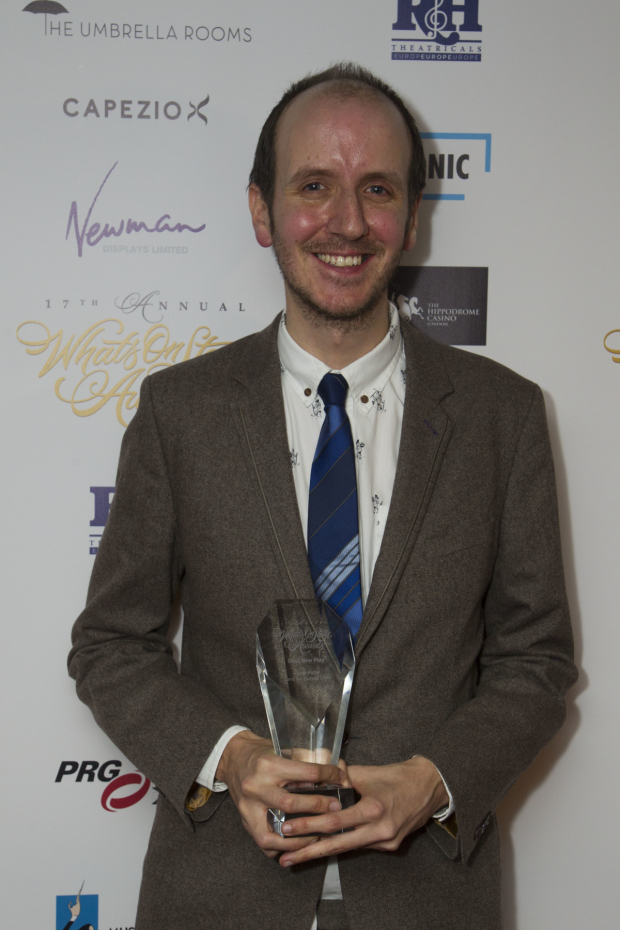 <p>Jack Thorne accepts the award for Best New Play for <em>Harry Potter and the Cursed Child</em></p><br />© Dan Wooller for WhatsOnStage