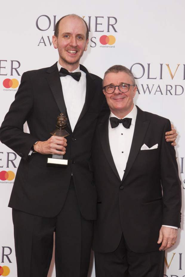 <p>Jack Thorne with the award for Best New Play for <em>Harry Potter and the Cursed Child</em> at Palace Theatre, presented by Nathan Lane</p><br />© Dan Wooller for WhatsOnStage