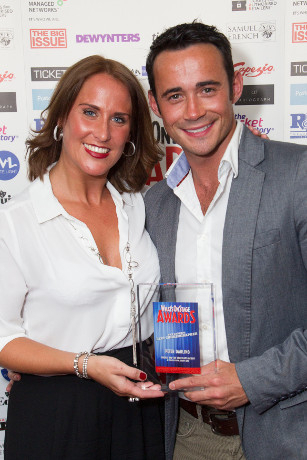 <p>Jane McMurtrie and Chris Piper accept the Award for Best Choreographer on behalf of Peter Darling for <em>Charlie and the Chocolate Factory</em></p><br />© Dan Wooller for WhatsOnStage