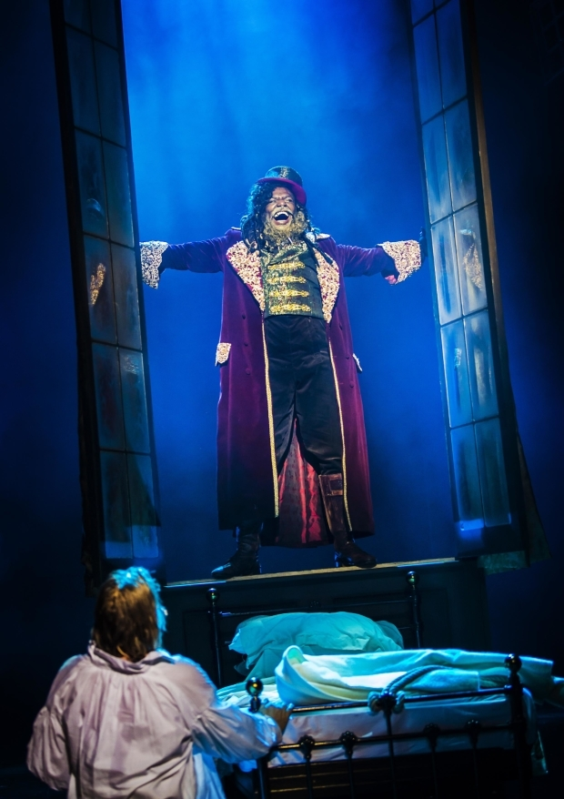 <p>Jasper Britton as Ebenezer Scrooge and Anton Stephans as The Ghost of Christmas Present</p><br />© Pamela Raith