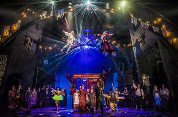 <p>Jasper Britton as Ebenezer Scrooge, Anton Stephans as Ghost of Christmas Present and the cast of <em>Scrooge the Musical</em> </p><br />© Pamela Raith