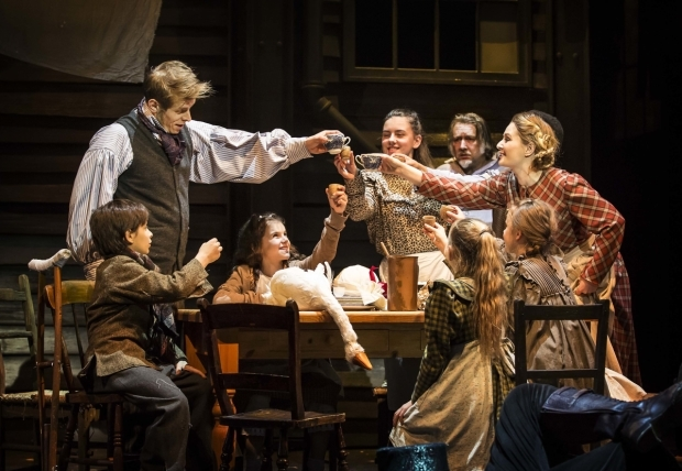 <p>Joe Maxwell as Bob Cratchit, Danny Freeman as Tiny Tim, Lara Denning as Mrs Cratchit and the young cast of <em>Scrooge the Musical</em></p><br />© Pamela Raith