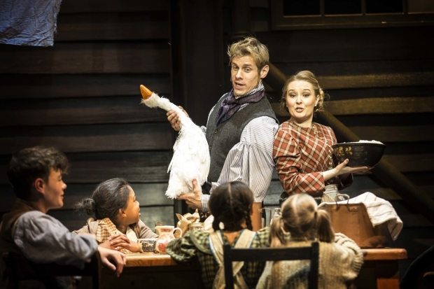 <p>Joe Maxwell as Bob Cratchit, Lara Denning as Mrs Cratchit and the young cast of <em>Scrooge the Musical </em></p><br />© Pamela Raith