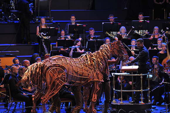 <p>Joey and conductor David Charles Abell at the <em>War Horse</em> Prom, BBC Proms 2014.</p><br />© BBC/Chris Christodoulou