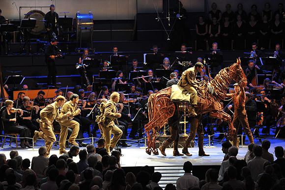 <p>Joey and members of the National Theatre Ensemble at the War Horse Prom, BBC Proms 2014.</p><br />© BBC/Chris Christodoulou