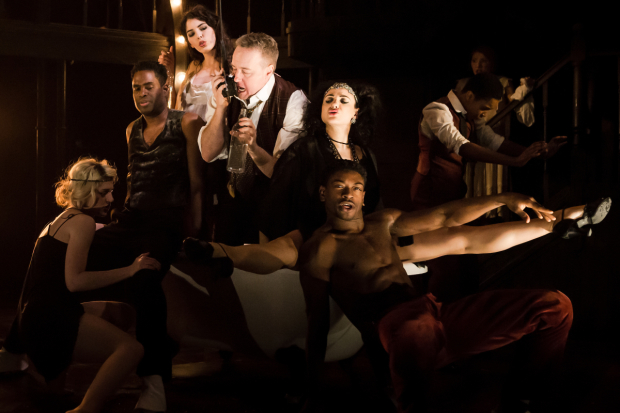 <p>John Owen-Jones as Burrs and Victoria Hamilton-Barritt as Kate (centre) with the cast of <em>The Wild Party</em></p><br />© Scott Rylander