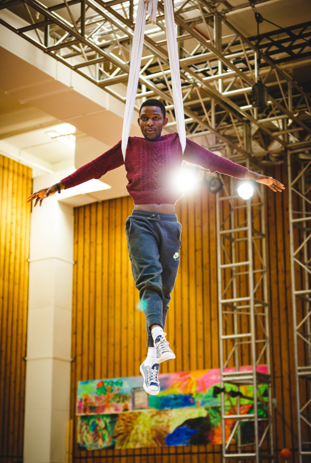 <p>John Pfumojena (Michael) rehearses flying for <em>Peter Pan</em></p><br />© Steve Tanner 2016