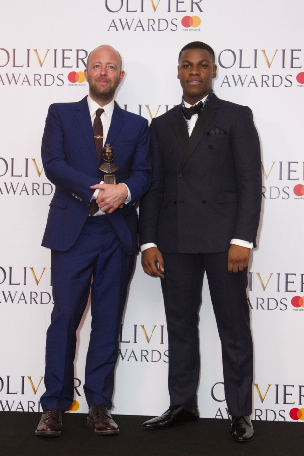 <p>John Tiffany with the award for Best Director for  <em>Harry Potter and the Cursed Child</em> at Palace Theatre, presented by John Boyega</p><br />© Dan Wooller for WhatsOnStage
