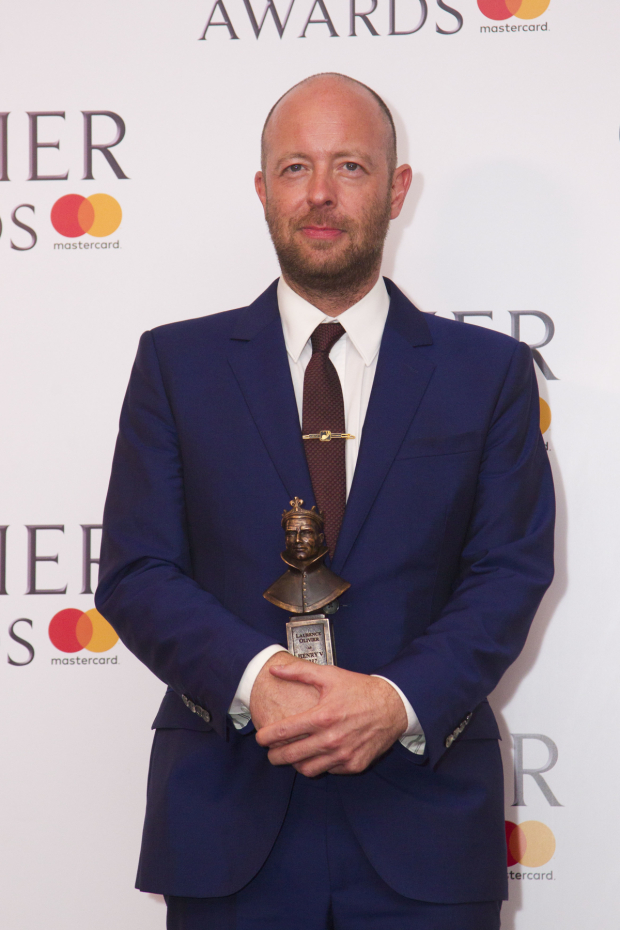 <p>John Tiffany with the award for Best Director for  <em>Harry Potter and the Cursed Child</em> at Palace Theatr</p><br />© Dan Wooller for WhatsOnStage