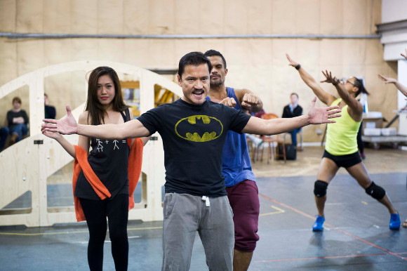 <p>Jon Jon Briones (The Engineer) and ensemble</p><br />© Robin Savage