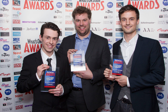<p>Jonathan Sayer, Henry Lewis and Henry Shields collect the Award for Best New Comedy for <em>The Play That Goes Wrong</em></p><br />© Dan Wooller for WhatsOnStage