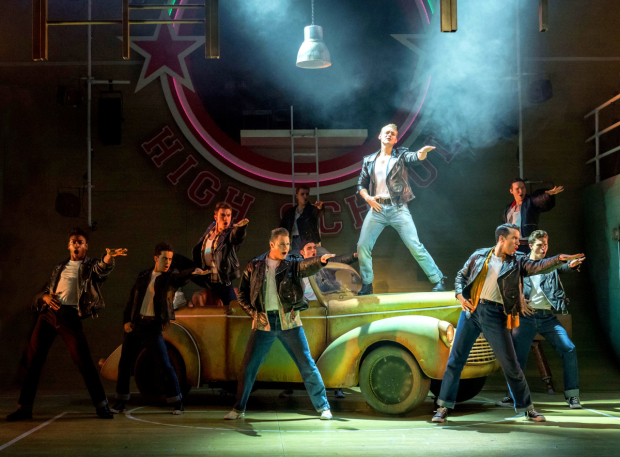 <p>Jonny Fines as Kenickie (on car) with The Burger Palace Boys  in <em>Grease</em> </p><br />© Manuel Harlan