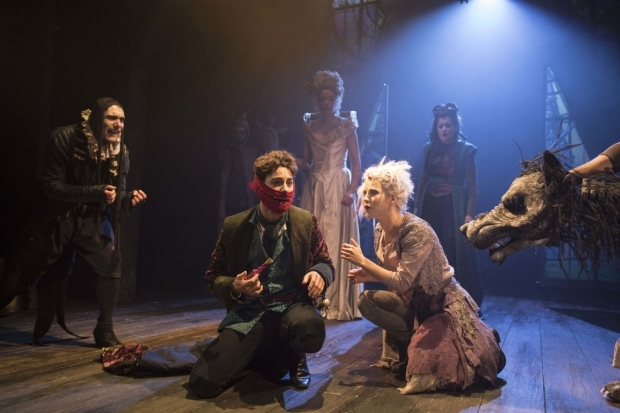 <p>Julian Bleach, Louis Maskell and Sanne den Besten with the company of <em>The Grinning Man</em></p><br />© Helen Maybanks