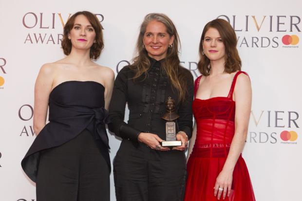 <p>Katrina Lindsay with the award for Best Costume Design for <em>Harry Potter and the Cursed Child</em> at Palace Theatre, presented by Charlotte Ritchie and Rose Leslie</p><br />© Dan Wooller for WhatsOnStage