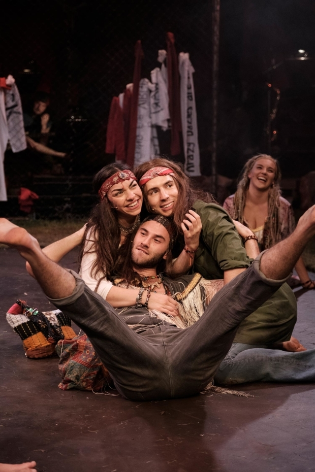 <p>Laura Johnson (centre), Andy Coxon (right) Robert Metson (left) in <em>Hair</em></p><br />© Claire Bilyard