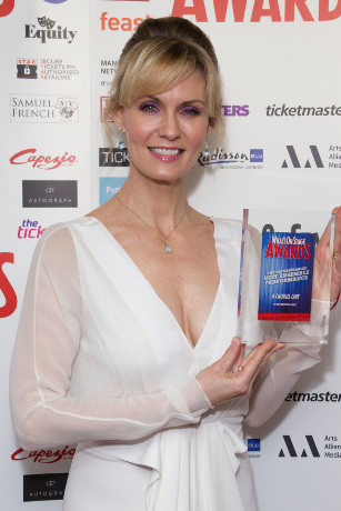 <p>Leigh Zimmerman collects the Award for Best Ensemble for <em>A Chorus Line</em></p><br />© Dan Wooller for WhatsOnStage