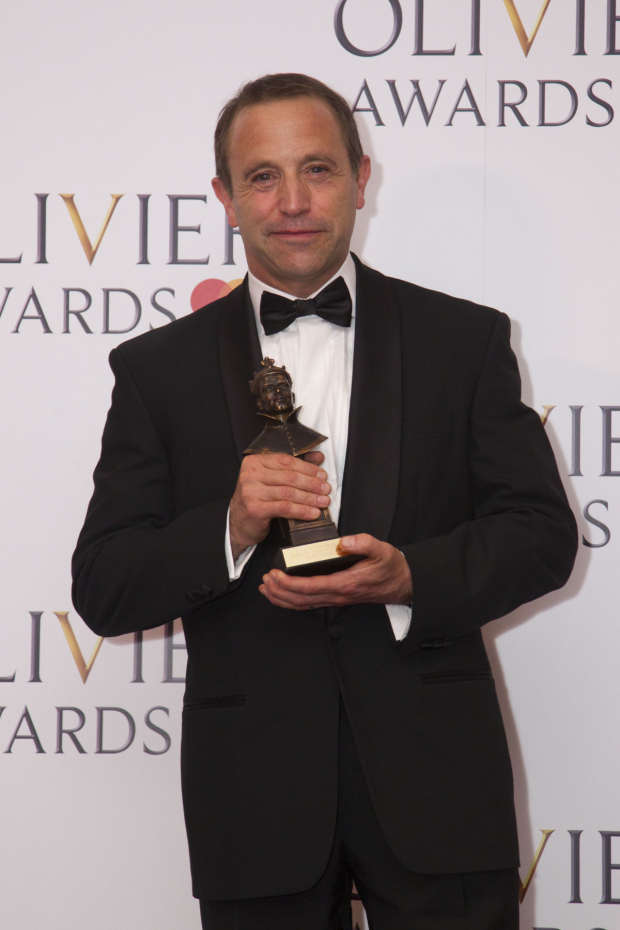 <p>Mark Wigglesworth with the award for Outstanding Achievement in Opera for <em>Don Giovanni</em> and <em>Lulu</em> at London Coliseum</p><br />© Dan Wooller for WhatsOnStage