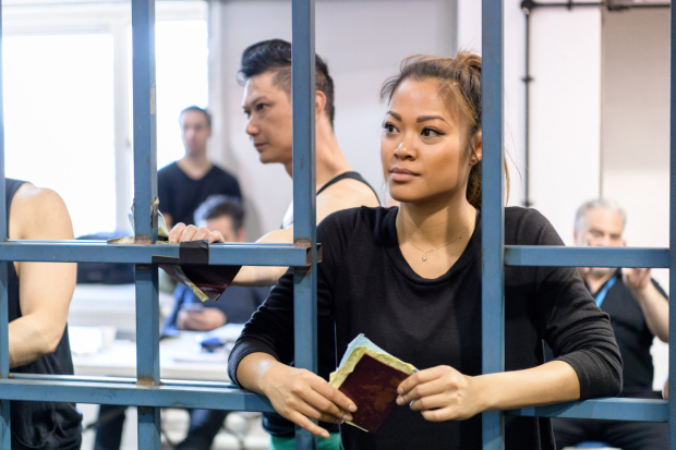 <p>Marsha Songcome (Gigi) and company of <em>Miss Saigon</em> in rehearsals</p><br />© Manuel Harlan