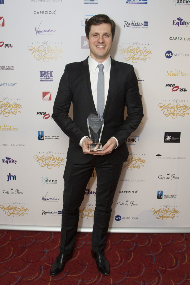 <p>Neil Austin accepts the award for Best Lighting Design for <em>Harry Potter and the Cursed Child</em></p><br />© Dan Wooller for WhatsOnStage