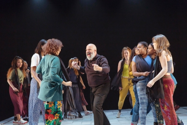 <p>Omar Ebrahim and the community chorus in <em>The Suppliant Women</em></p><br />© Stephen Cummiskey