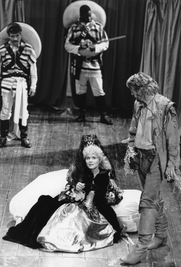 <p>Patrick Robinson (far back) as a servant in John Barton&#39&#x3B;s 1986 production of <em>The Rover</em>.</p><br />© Donald Cooper