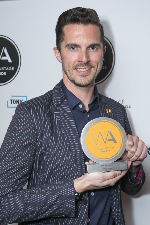 <p>Simon Adkins accepts the award for Best Choreography for <em>42nd Street</em> on behalf of Randy Skinner</p><br />© Dan Wooller for WhatsOnStage