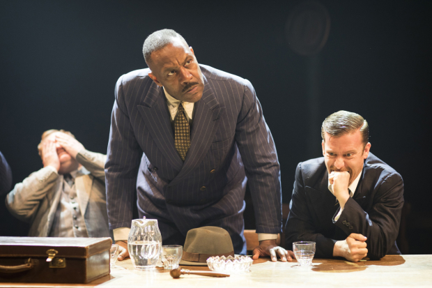 <p>Simon Holland Roberts (Grocer 2), Lenny Henry (Arturo Ui) and Philip Cumbus (Clark) in <em>The Resistible Rise of Arturo Ui</em></p><br />© Helen Maybanks