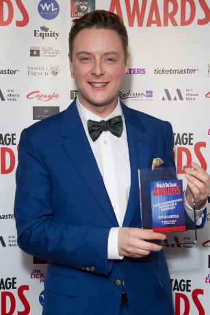 <p>Stephen Ashfield collects the Award for Best Supporting Actor in a Musical for <em>The Book of Mormon</em></p><br />© Dan Wooller for WhatsOnStage